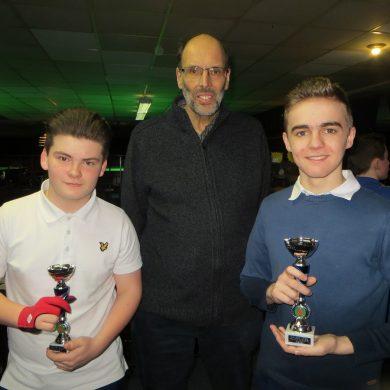 Hughes denies Russell first winner's trophy