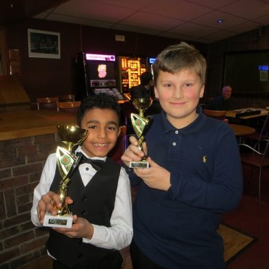 Two nine-year-olds collect first Cuestars trophies